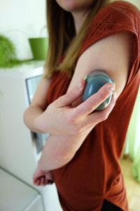 Inserter with sensor on arm